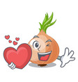 with heart fresh onion isolated on the mascot vector image