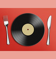 vinyl record disc with fork and table knife vector image vector image