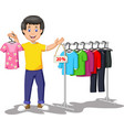 funny shopkeeper man with discount clothes cartoon vector image vector image