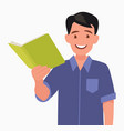 man is holding a book in his hand vector image vector image