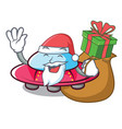 santa with gift ufo mascot cartoon style vector image