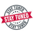 stay tuned round grunge ribbon stamp vector image vector image