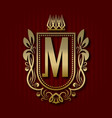 golden royal coat of arms with m monogram vector image