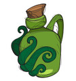 Green glass bottle of an unusual shape with a