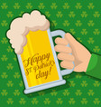 happy st patricks day hand holding beer glass vector image vector image