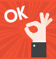 okay hand sign with sun burst background vector image vector image