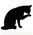 Image - cat silhouette in Cleaning Paw pose vector image