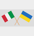 crossed ukraine and italy flags vector image vector image