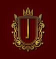 golden royal coat of arms i monogram vector image vector image