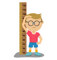 little nerd boy with glasses measuring his height vector image