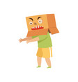 boy playing scary monster with a cardboard box on vector image
