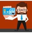 Lucky businessman is presenting a credit card vector image