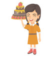 little caucasian girl holding a chocolate cake vector image