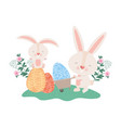 rabbits with wheelbarrow and easter eggs icon vector image