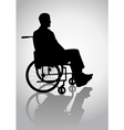 Silhouette of a person on a wheelchair