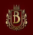 golden royal coat of arms b monogram vector image vector image