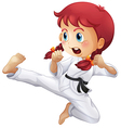 An energetic little girl doing karate vector image vector image