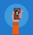 hand holding a mobile phone with a skull symbol vector image