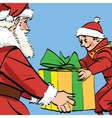 Santa Claus gives the boy a box of gifts vector image