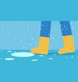 feet man in rain boots walk on road with rain vector image