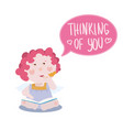 little angel sitting with a notebook writing poem vector image vector image