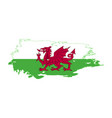 grunge brush stroke with wales national flag vector image vector image
