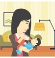 Mother feeding baby vector image