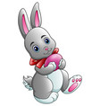 cartoon rabbit carrying easter egg vector image vector image