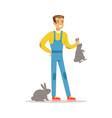 farmer woman caring for rabbits farming and vector image