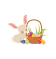 cute cartoon bunny and basket full of colored eggs vector image vector image