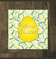 Easter greeting card with yellow tulips on wooden