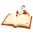 santa pointing book vector image vector image