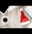 christmas office background with santa hat tablet vector image vector image