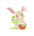 cute cartoon bunny in green bow holding basket vector image vector image