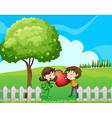 A couple at the hilltop near the wooden fence vector image vector image
