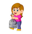 happy young woman holding garbage bag vector image vector image