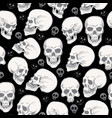 Seamless pattern with skulls on black blackground