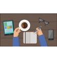 Hands with Cup Of Coffee and Pen in Workspace vector image