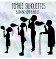 Female silhouettes blowing soap bubbles vector image