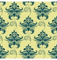 Green paisley floral pattern on yellow background