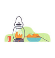 lantern and cup with potatoes in a clearing vector image