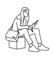 a woman with backpack sitting on cube looking at vector image vector image