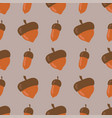 cute seamless pattern made of brown acorns vector image