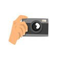 hand taking photo with camera vector image vector image