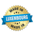 made in Luxembourg gold badge with blue ribbon vector image vector image