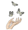 beautiful female hands release a flock of vector image vector image