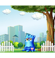 A blue monster standing near the fence across the vector image vector image