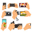 hand taking pictures with smartphone and camera vector image