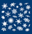 set of white snowflakes on blue background vector image vector image