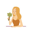 Displeased face woman with broccoli on a diet flat
